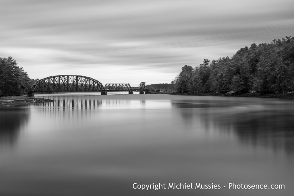 Monochrome print Wiscasset, Maine US. Long exposure, Decomissioned railroad bridge over