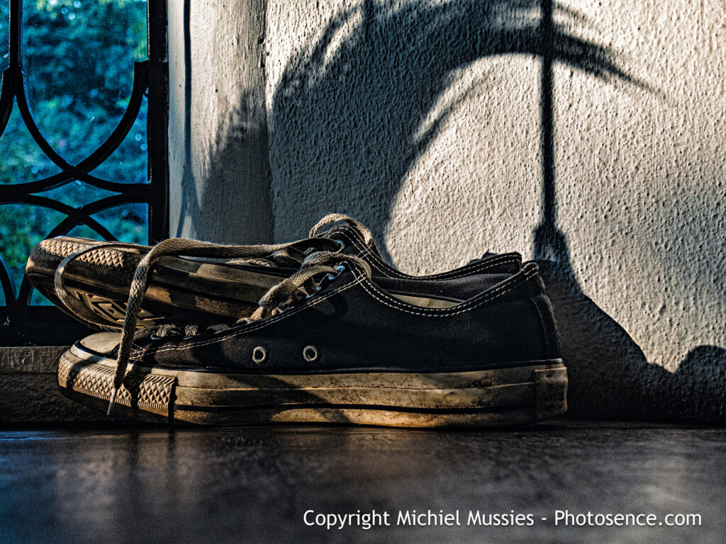 Product image for colour print depicting a pair of shoes in the afternoon sunlight